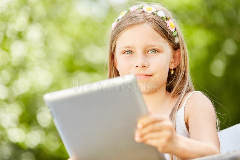 Girl learns how to use tablet and internet royalty free stock photography