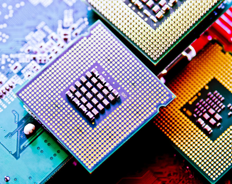 Computer cpu (central processor unit) chip. On mainboard close up stock image