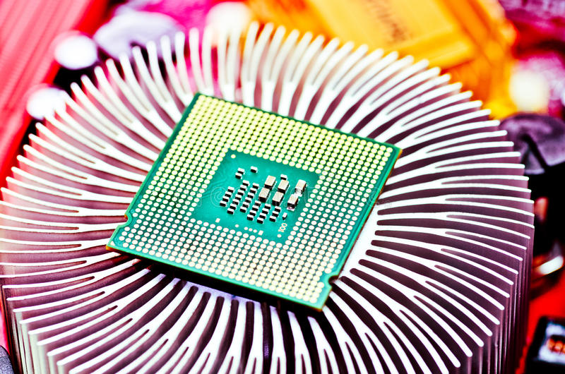 Computer cpu (central processor unit) chip. On Cooling pad stock image