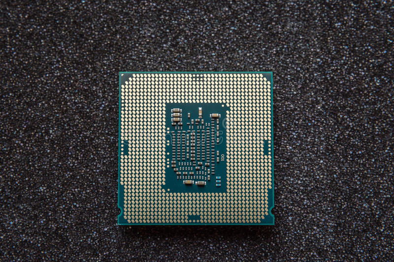 Computer cpu (central processor unit) chip on mainboard.  royalty free stock photos