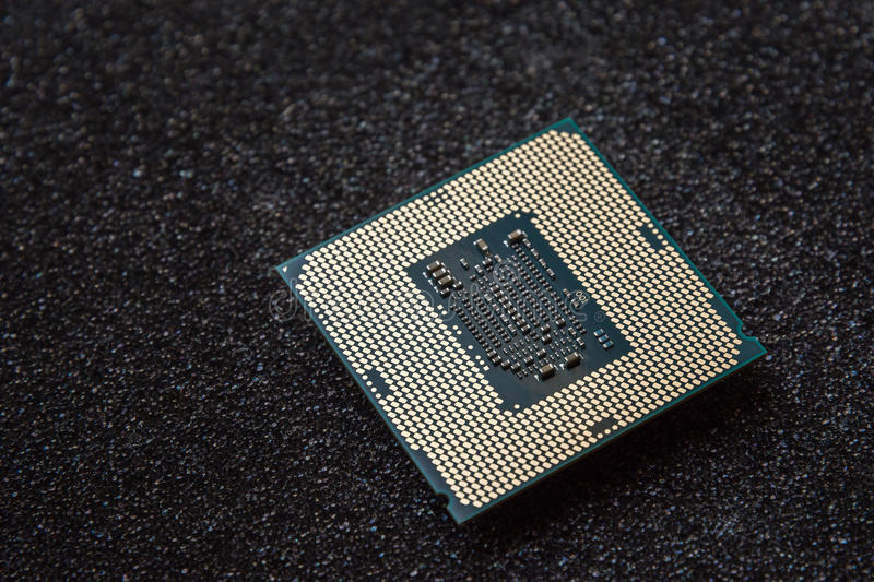Computer cpu (central processor unit) chip on mainboard.  royalty free stock images