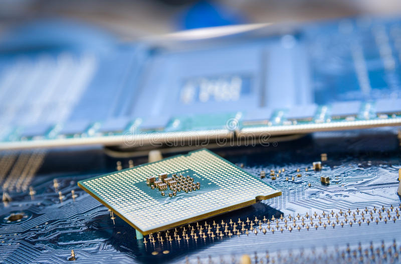 Computer cpu or central processor unit chip on mainboard. Technology background with computer processors CPU concept and blue circuit, board texture stock photo