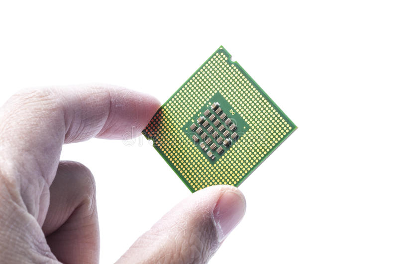 Computer CPUchip. Central processing chip of a computer held by a hand royalty free stock images