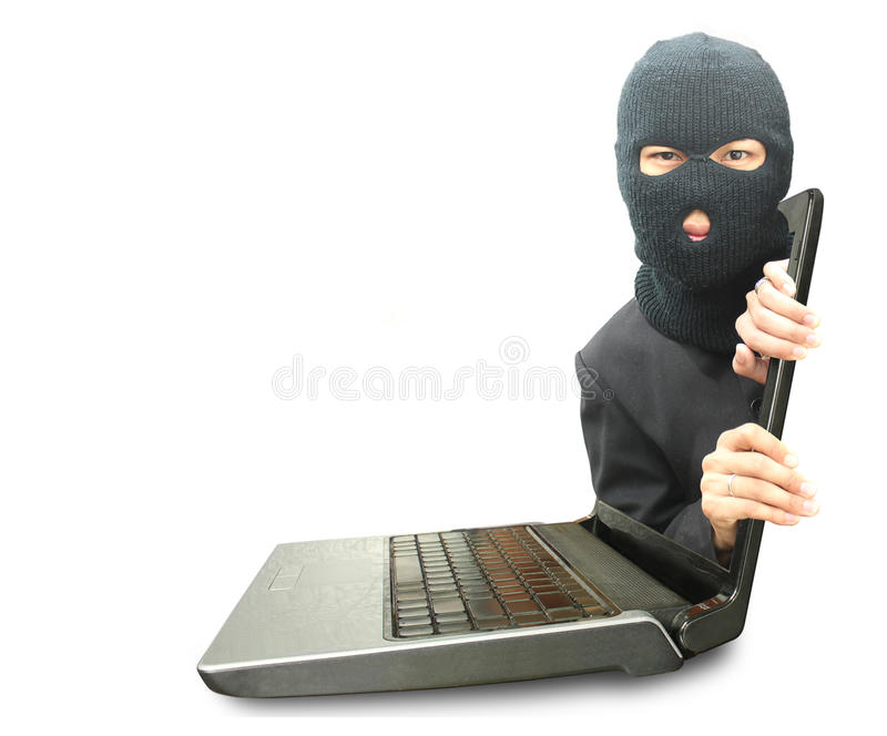 Computer crime concept. Black mask man out laptop royalty free stock image