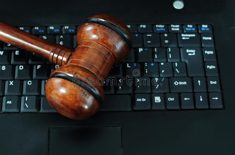 Computer crimes. Photo of a gavel on laptop keyboard royalty free stock photo