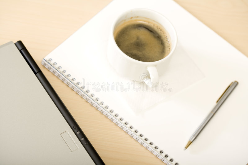 Computer with a cup of coffee stock image