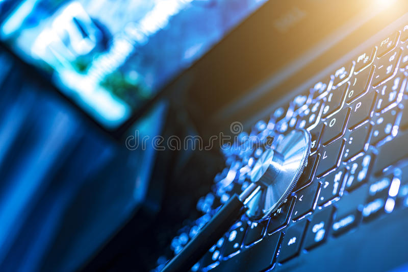 Computer or data analysis - Stethoscope over a computer keyboard royalty free stock image