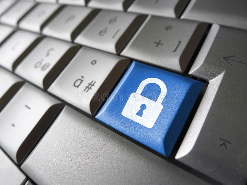 Computer Data Security Key. Internet, web and computer data security concept with padlock icon and symbol on a blue laptop key for website and online business