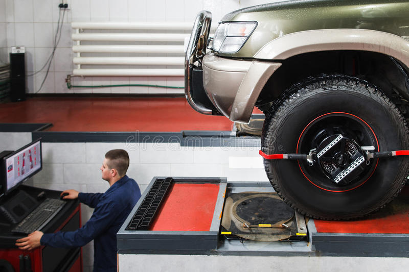 Computer diagnostics of wheel alignment for SUV royalty free stock photo