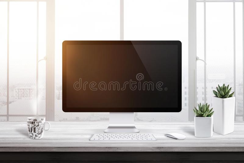 Computer display with blank screen for mockup in office or work room. Window and sun light in background royalty free stock photography