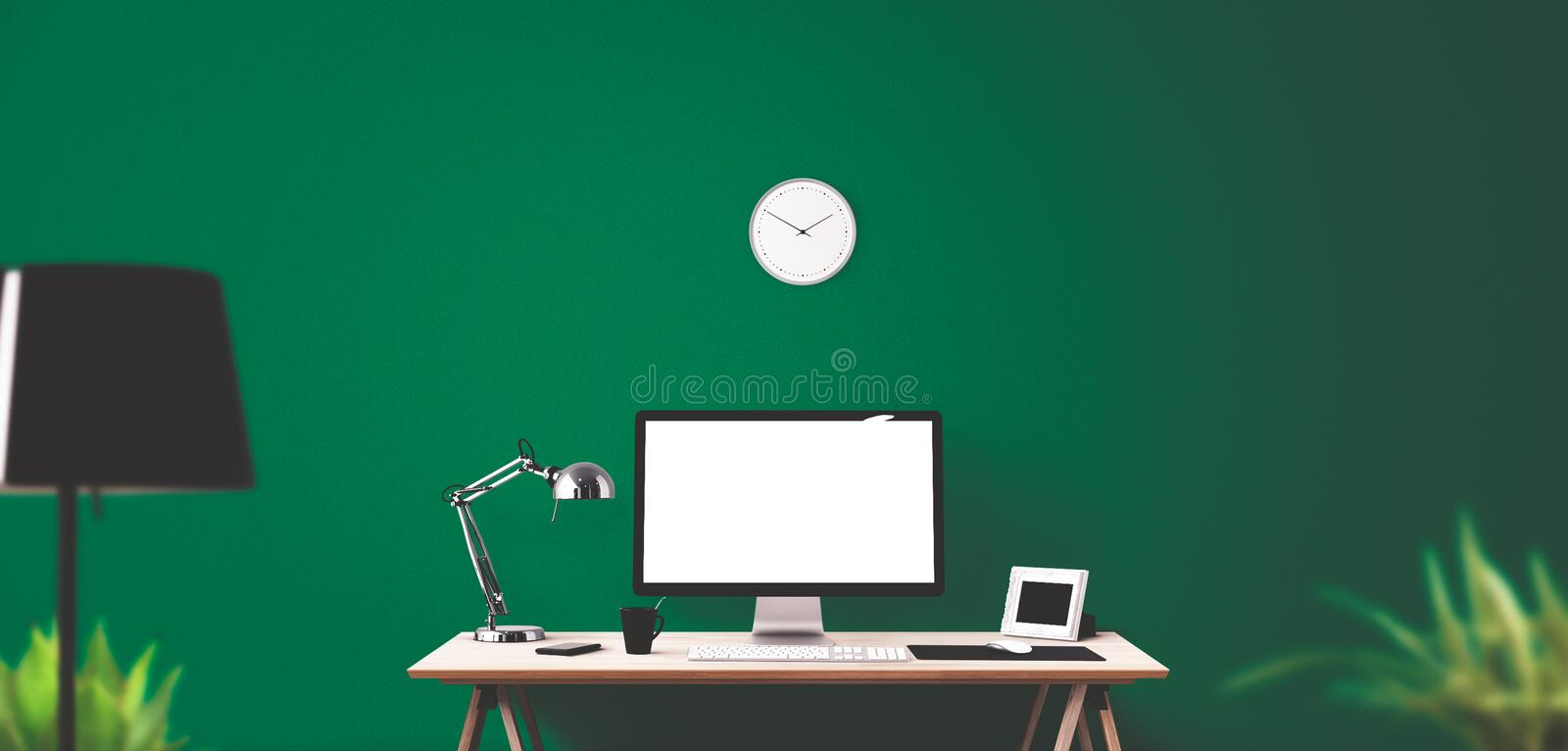 Computer display and office tools on desk. Desktop computer screen . Modern creative workspace background. Front view stock photography