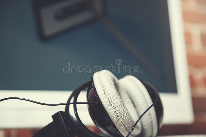 Computer with earphone. On the table in office royalty free stock photos