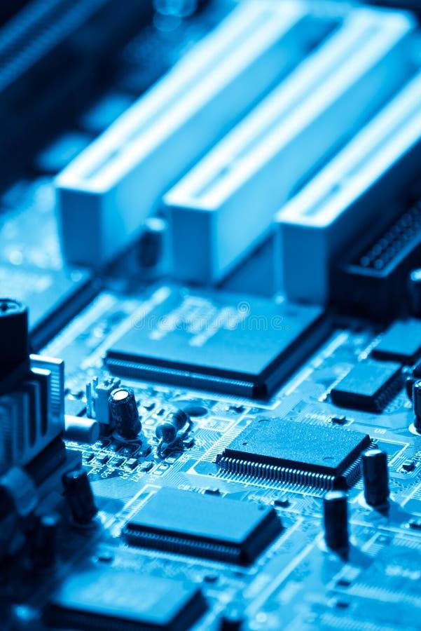 Computer electronics. Closeup of computer electronics blue toned royalty free stock image