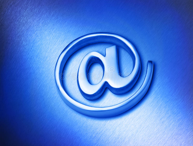 Computer Email At Sign @. A metal @ email at sign on a blue metallic brushed background