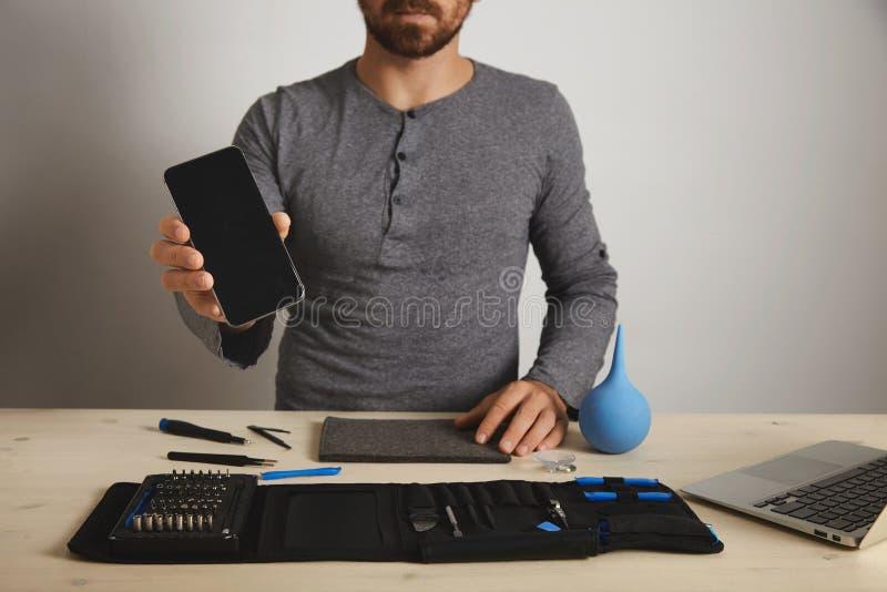 Computer en telefoon de repairmentdienst stock foto