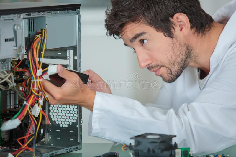 Computer engineer solving problem royalty free stock image