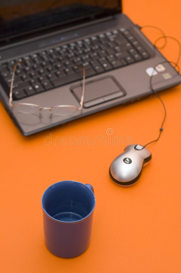 Computer With Eyeglasses And Cup Royalty Free Stock Image