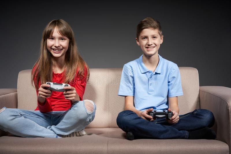 Computer game competition. Gaming concept. Excited girl playing video game with joystick royalty free stock image