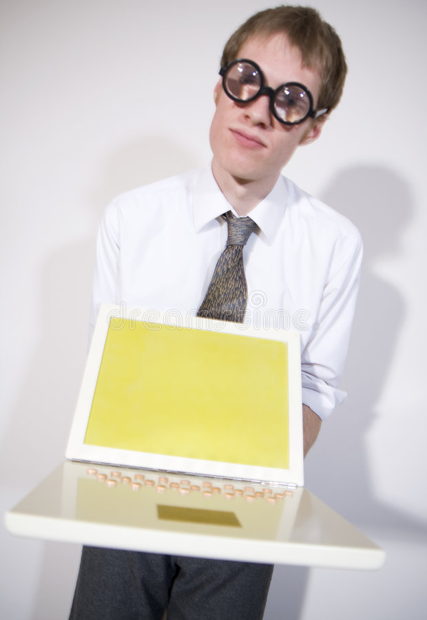 Computer Geek. A young computer repair man holding a unbranded laptop computer vector illustration