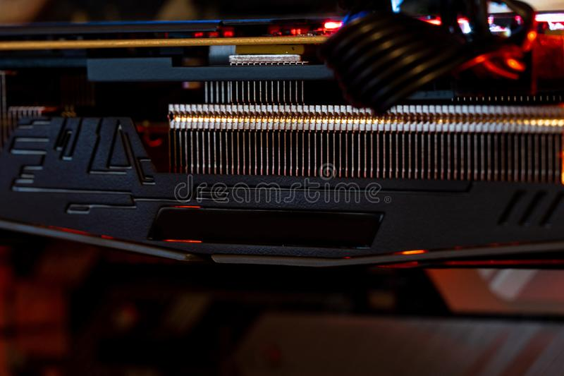 Computer graphic card, CPU Cooler. Computer circuit board and CPU cooling fans illuminated by internal LEDs stock images