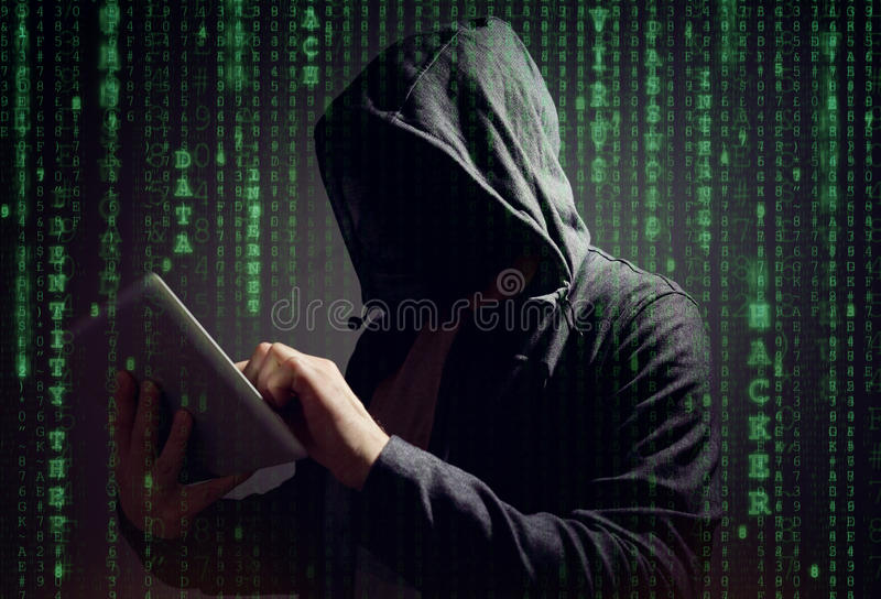 Computer hacker with digital tablet. Stealing data concept for network security or ransomware royalty free stock images