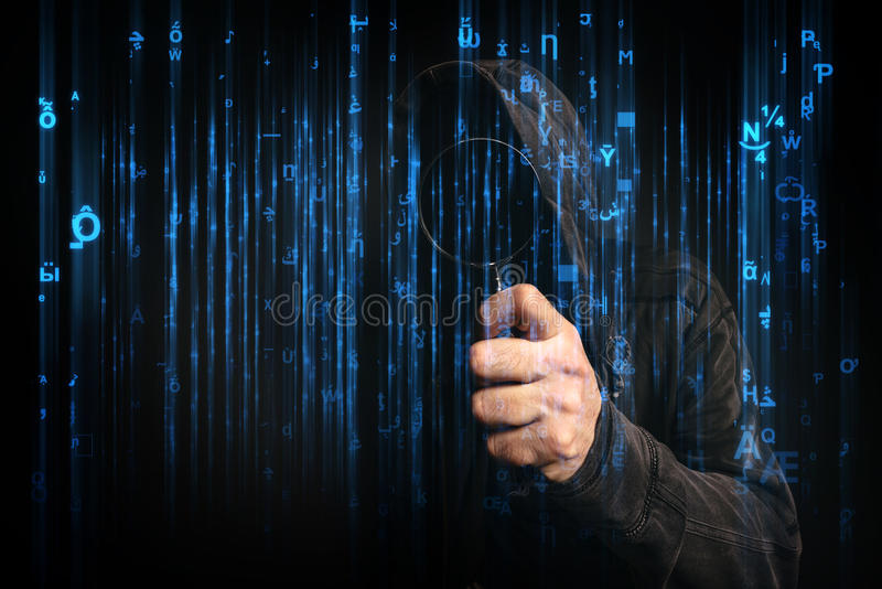 Computer hacker with hoodie in cyberspace surrounded by matrix c. Ode, online internet security, identity protection and privacy royalty free stock photography