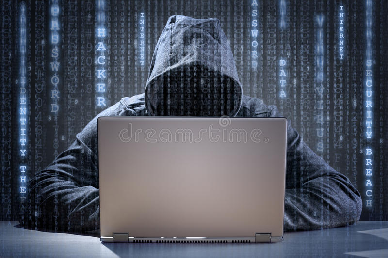 Computer hacker stealing data from a laptop. Concept for network security, identity theft and computer crime royalty free stock photos