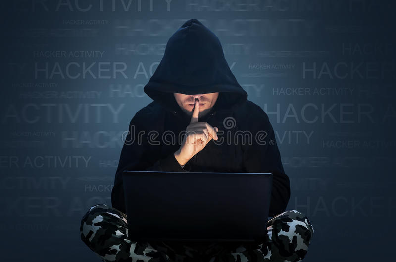 Computer hacker stealing data from a laptop stock images