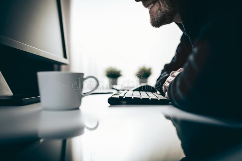 Computer hacker stealing information from web stock photography