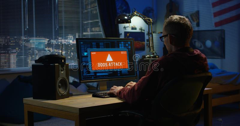 Computer hacker using his computer stock image