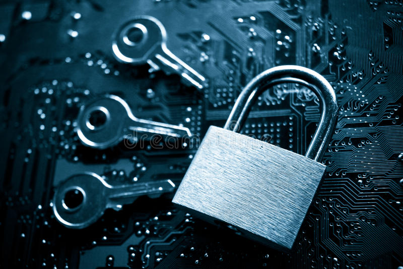 Computer hacking. A security lock on a computer circuit board surrounded by keys / random password hacking concept royalty free stock photos
