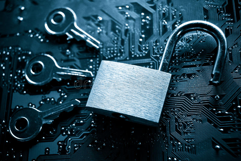 Computer hacking. Unlock security lock on a computer circuit board surrounded by keys / random password hacking concept stock photo