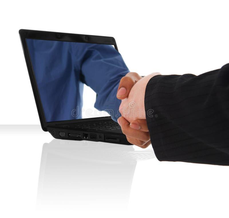 Computer hand shake royalty free stock photography