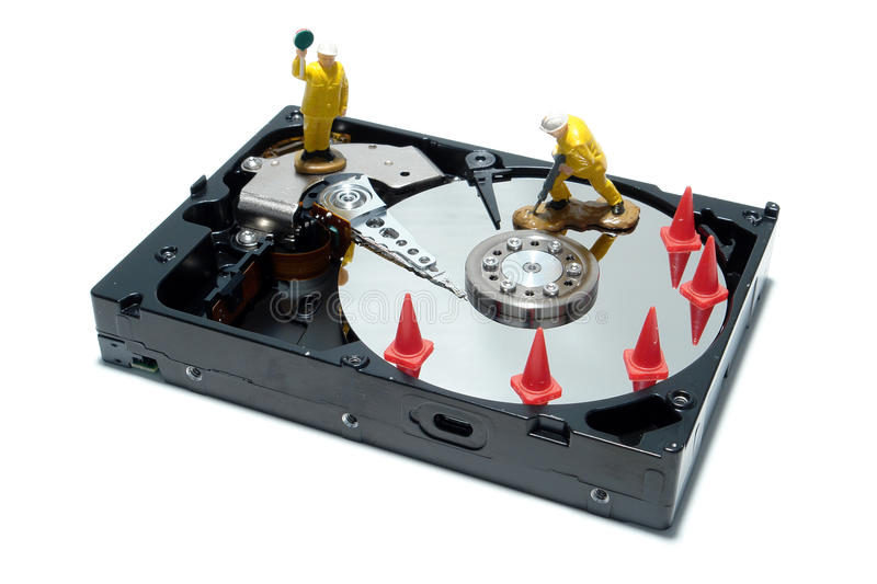 Computer Hard Disc Drive Concept for Repair. Open computer hard disc drive hardware component with miniature toy figurines work crew over white as concept royalty free stock photo
