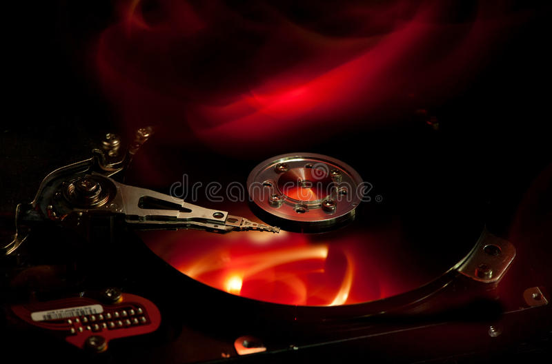 Computer hard drive on fire royalty free stock image