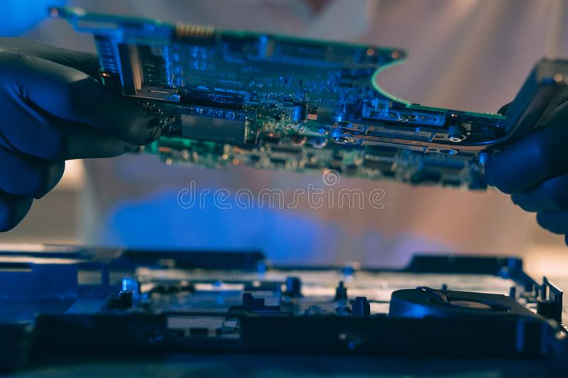 Computer hardware microelectronics component. Computer hardware development. microelectronics technology science concept. engineer holding a computer component royalty free stock photography