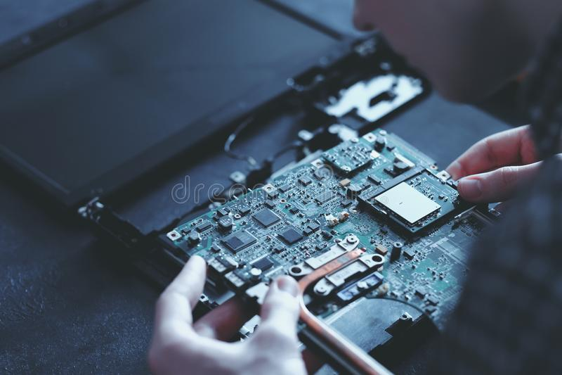 Computer hardware microelectronics motherboard. Computer hardware development. microelectronics technology science concept. engineer holding modern motherboard stock photography