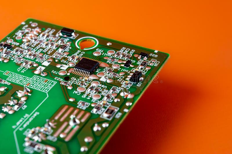 Computer hardware, microprocessor installed on circuit board. On orange background royalty free stock photos