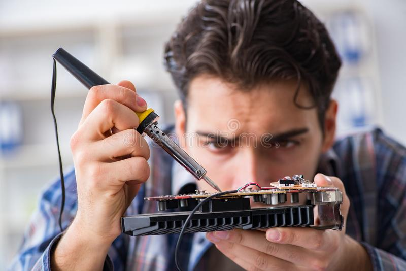 Computer hardware repair and fixing concept by experienced techn. Ician stock photos