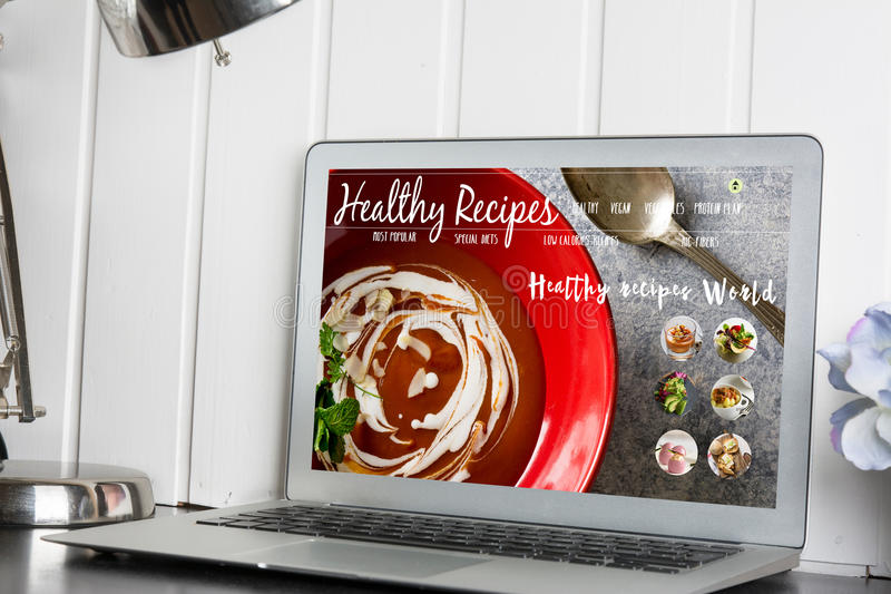 Computer, with healthy recipes blog on screen. web with nutritio. Us food stock image