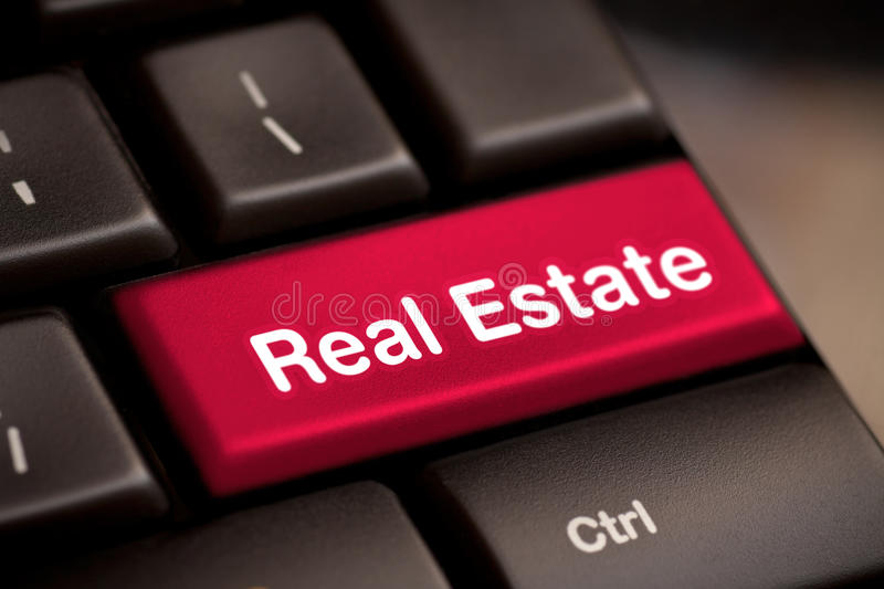 Computer key concept. Computer keyboard with real estate key royalty free stock images