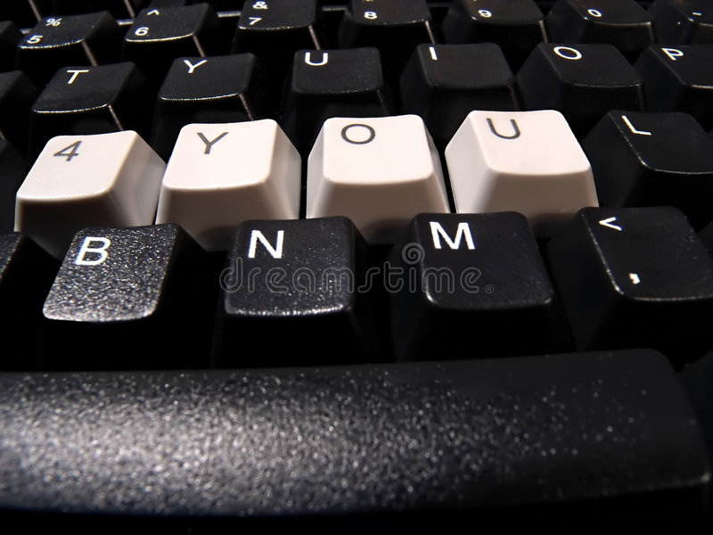 Computer keyboard. Black computer keyboard, with 4 you word stock image
