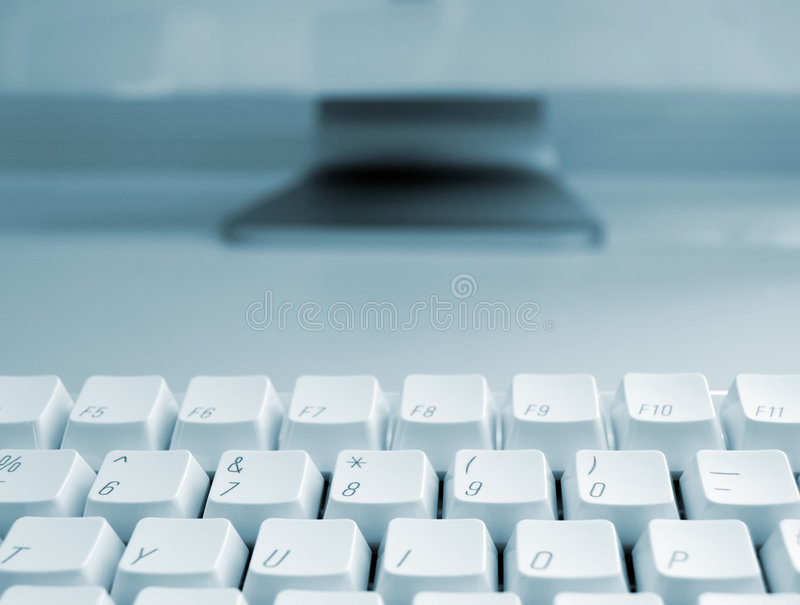 Computer keyboard in blue stock photo