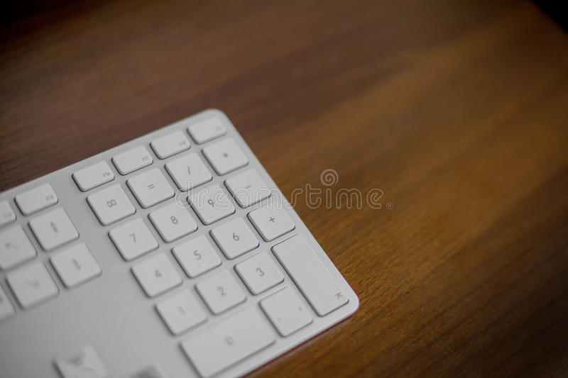 Computer keyboard on brown table. Computer keyboard on brown brown table stock photography