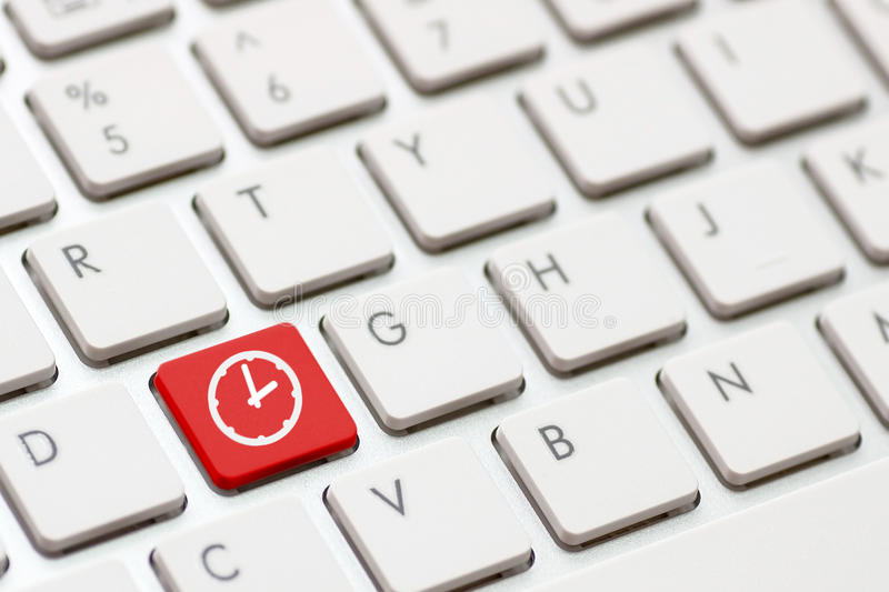 Computer keyboard with Clock stock photo