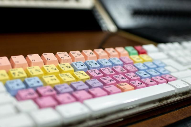 Computer keyboard with colored and mixed keys for audio and video editing. professional keyboard with shortcuts to facilitate. Video and audio editing through stock photos
