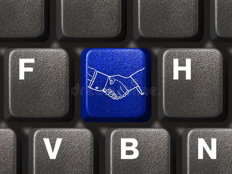 Computer keyboard with handshake button royalty free stock image