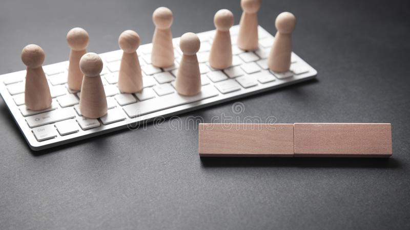 Computer keyboard and human figures. Social media, Network, Contact royalty free stock photo