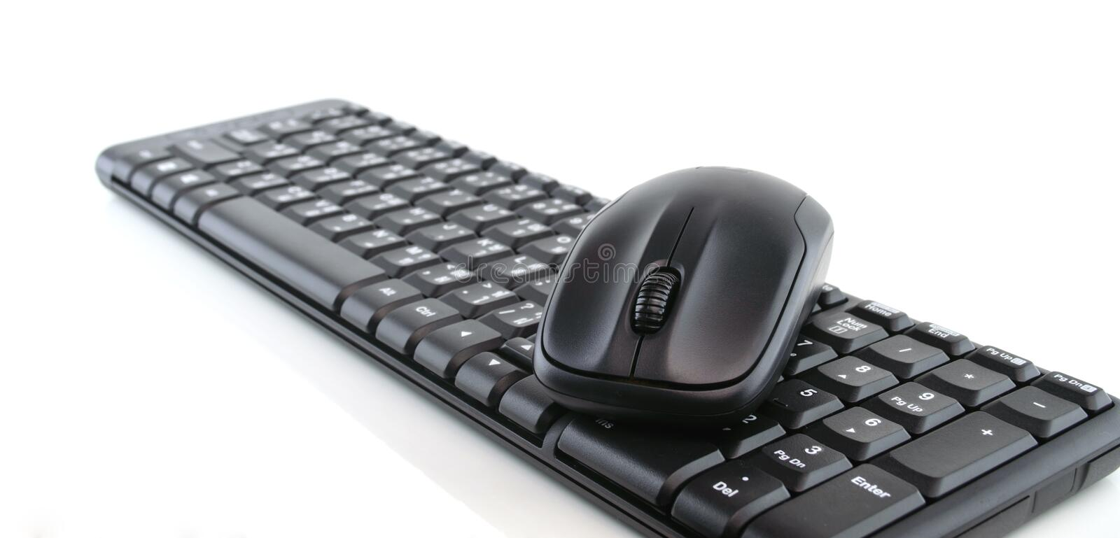 Computer keyboard and mouse isolated on white stock photos