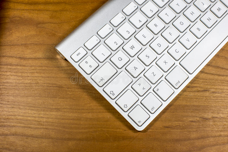 Computer Keyboard. In a table with wood background royalty free stock photography